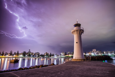 Lightning breaking behind the historic Wollongong lighthouse.