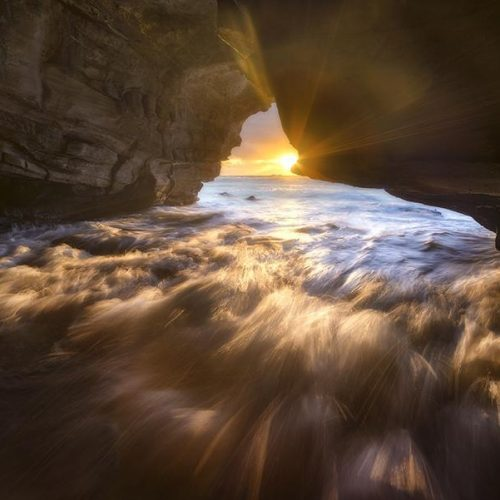 Sunrise within a sea cave.