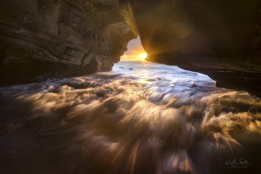 Sunrise within a sea cave.