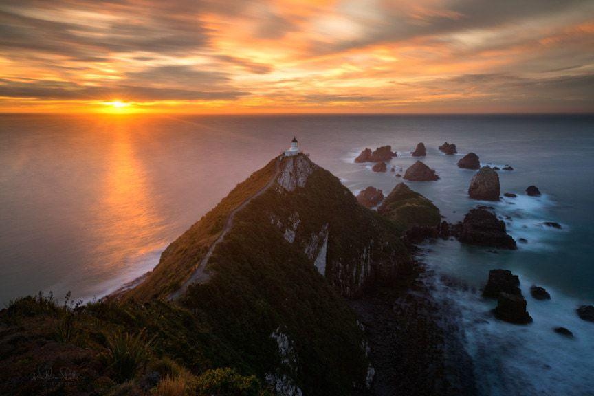A lighthouse at sunrise.