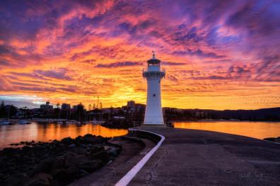 AN intense sunset over a lighthouse.