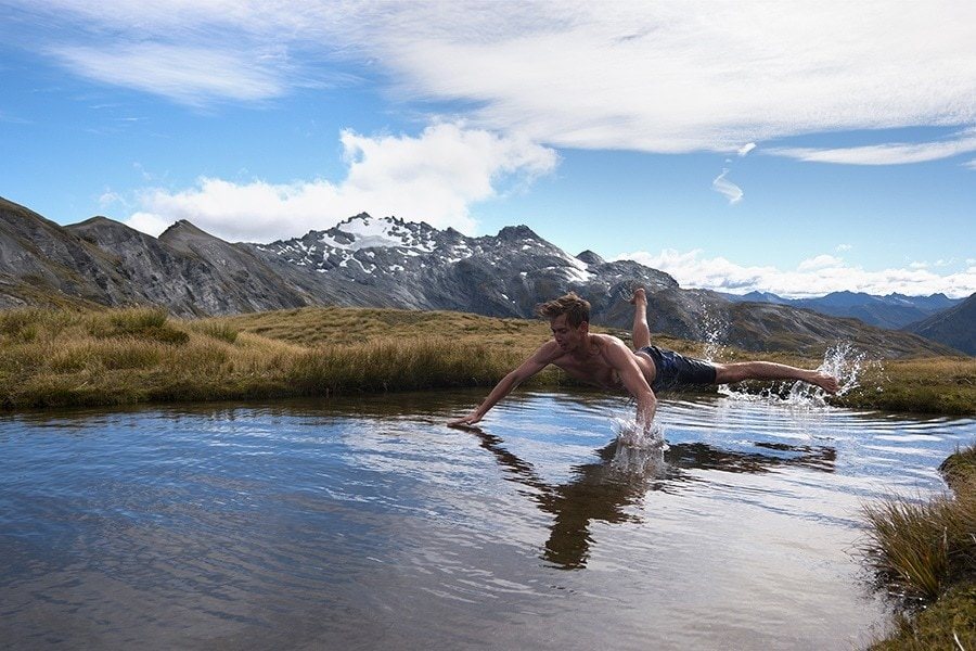 A man swimming in a tarn