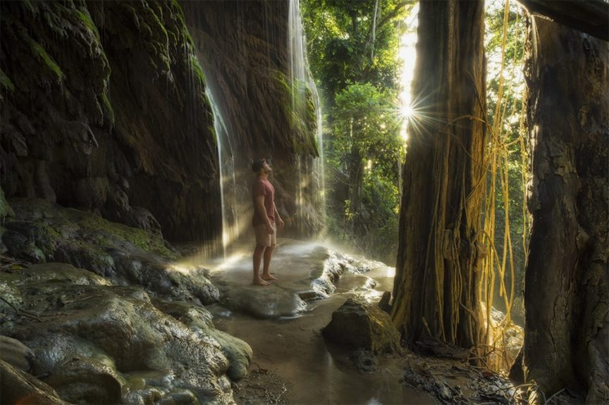A jungle waterfall at dusk.