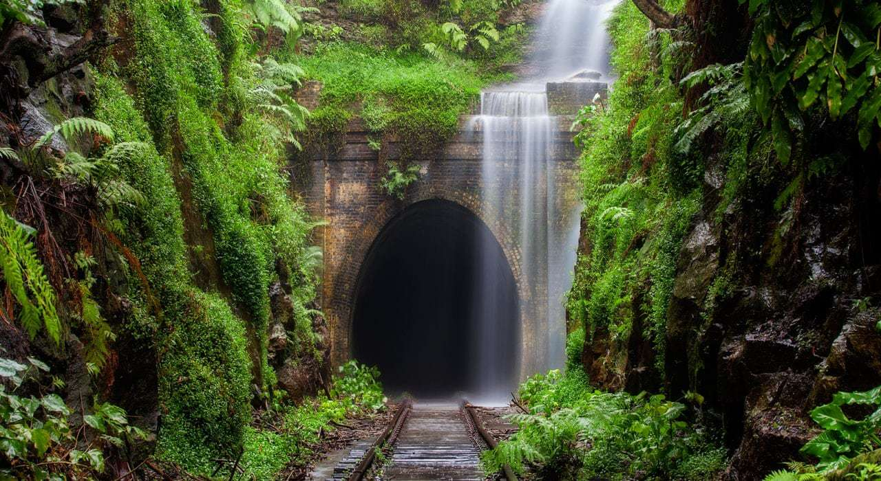 A waterfall running over a train tunnel