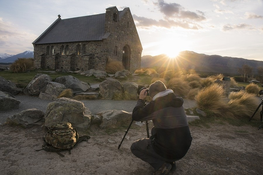 A man photographing a church
