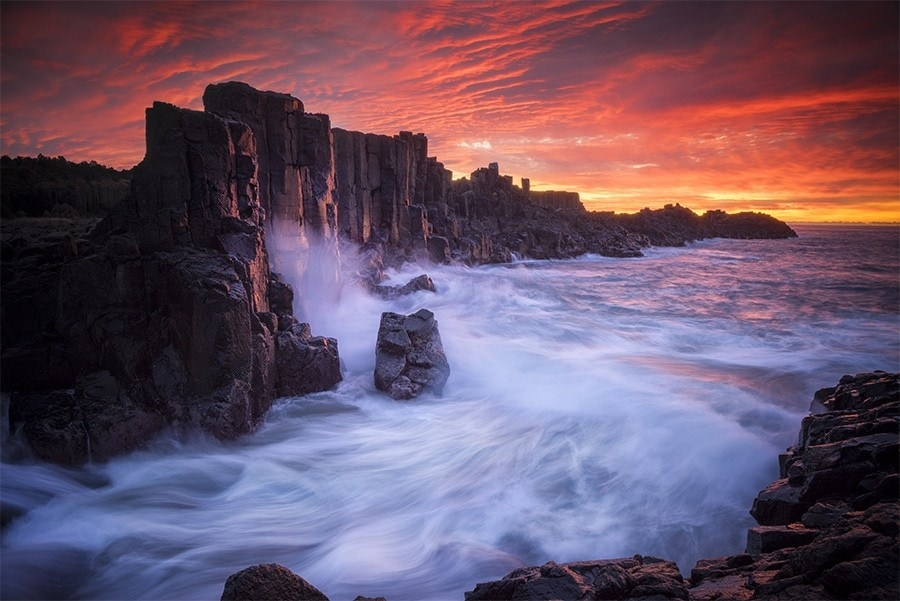 Sunrise by a rocky coast