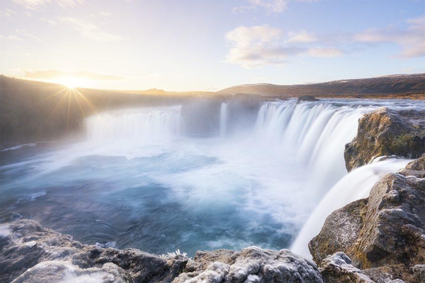 A frozen waterfall sunrise