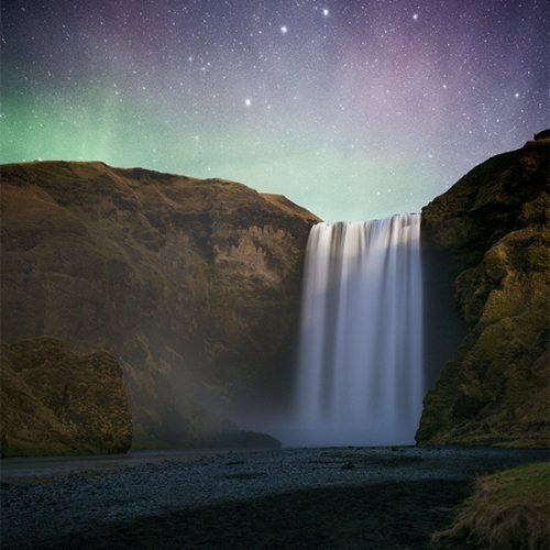 The Aurora over a waterfall