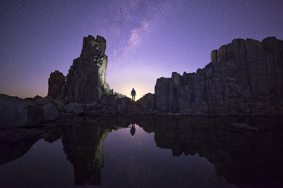 A man standing under the stars