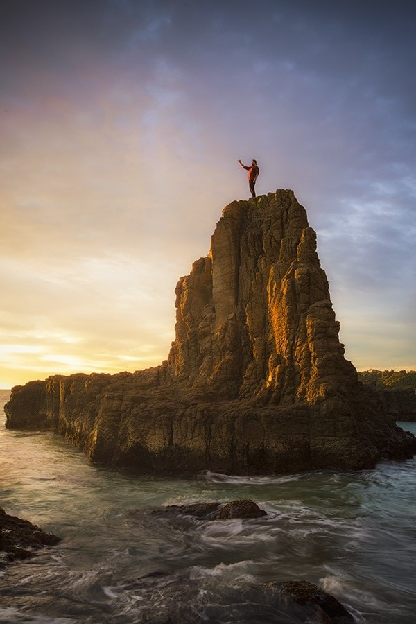 A man standing on top of Cathedral Rocks
