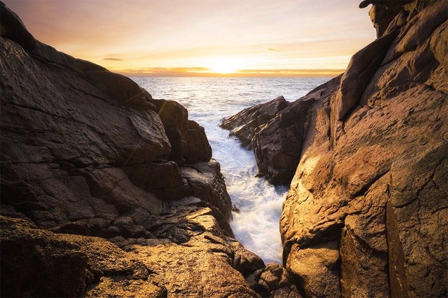 A sea cave at sunrise