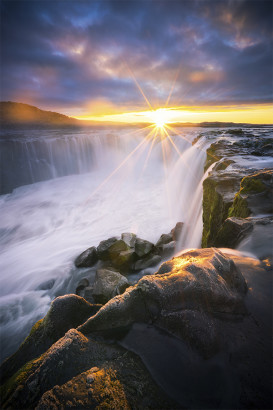 Sunrise over an icy waterfall