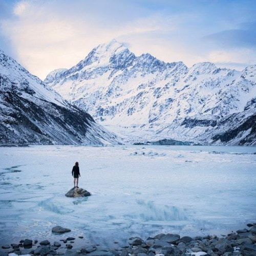 A man standing on a frozen lake