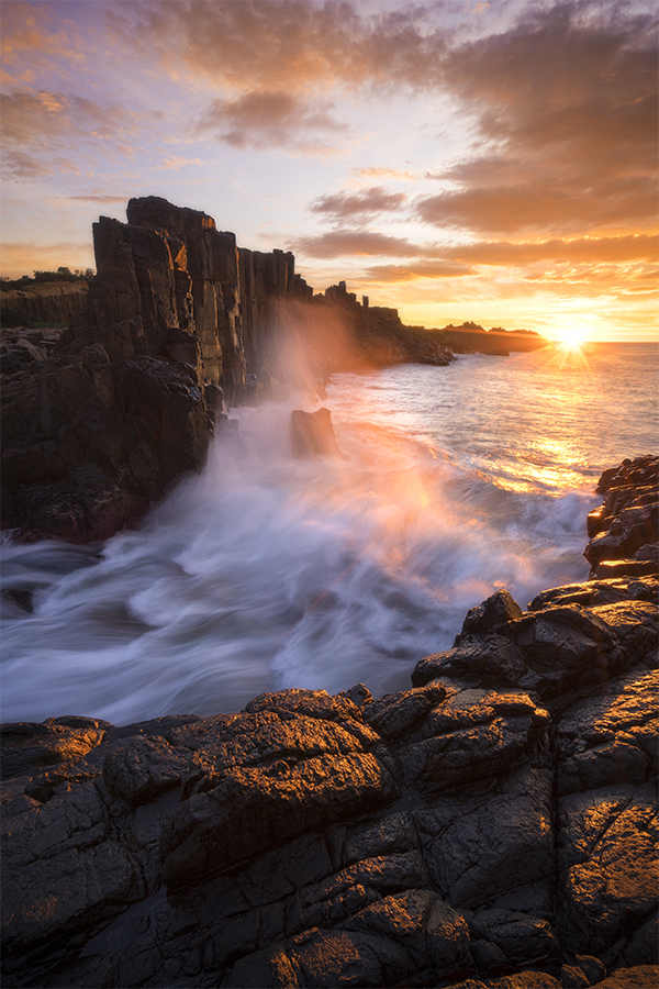 Sunrise by the basalt columns at Bombo Quarry Australia