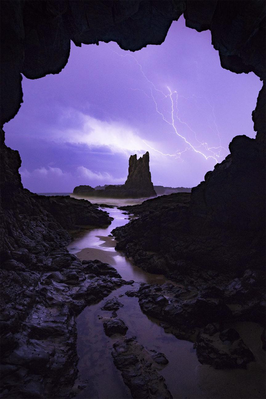 Lightning storm sea cave