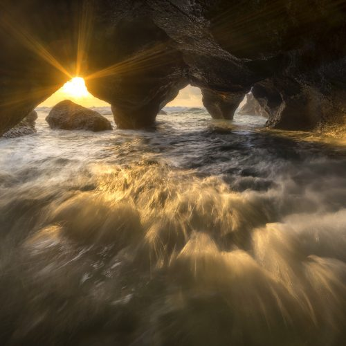 Sea cave sunrise