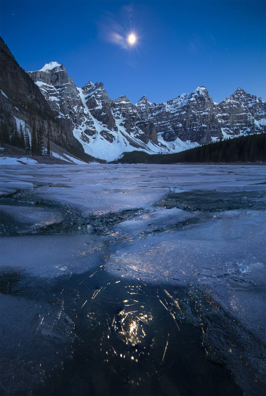 Moonlight above frozen Moraine Lake Alberta Canada