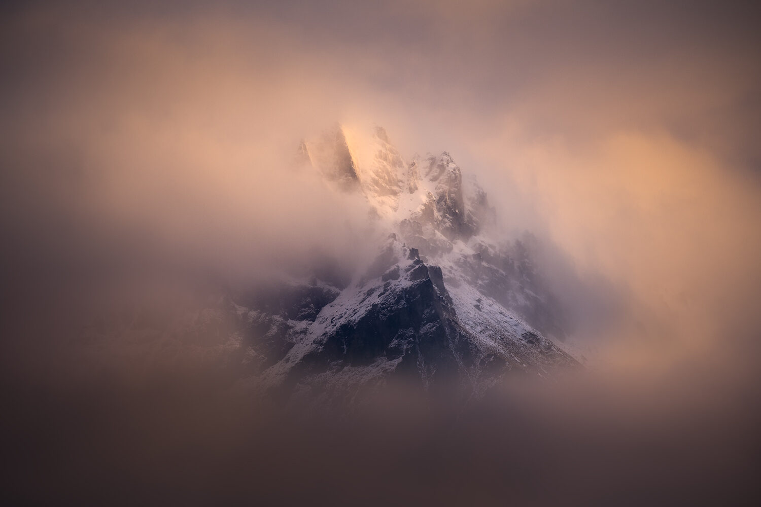 Mountain peeking through the cloud, New Zealand