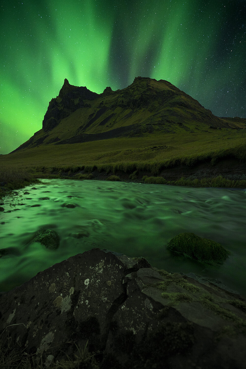 Northern Lights above a mountain in Vik, Iceland