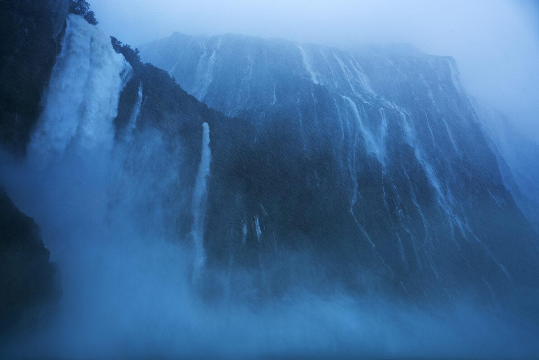 Towering waterfalls and heavy rain in Fiordland, New Zealand