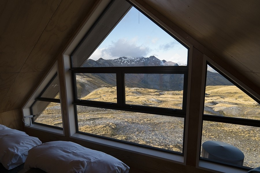 Looking out the window of a mountain chalet.