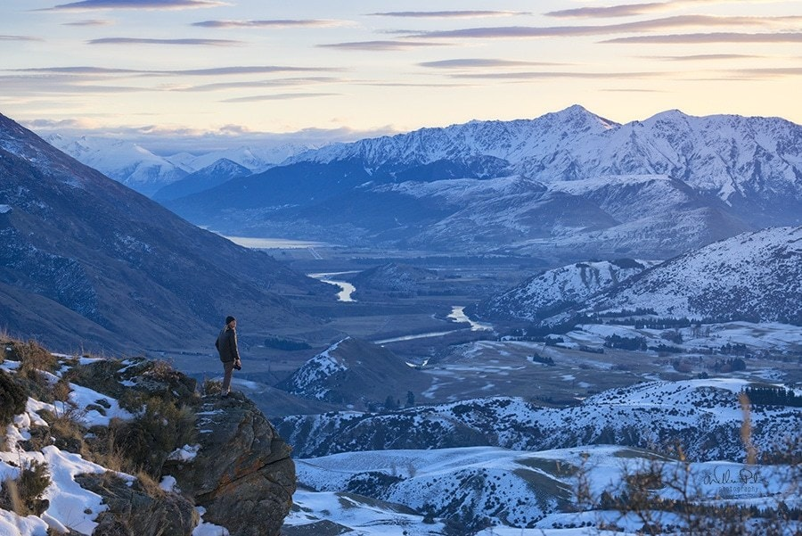 A man overlooking a snow covered landscape. Queenstown New Zealand.