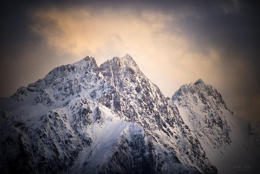 Snowy mountain peaks at sunset.