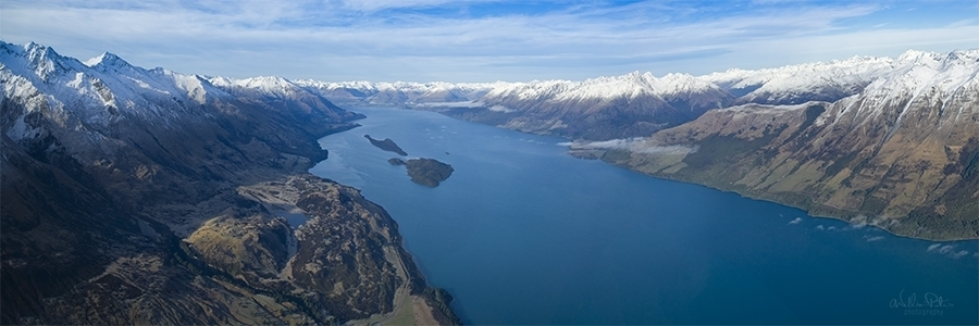 Aerial view of New Zealand mountains and lake.