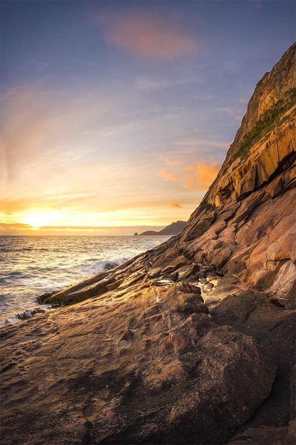 Sunrise by the rocky coast of Tasmania