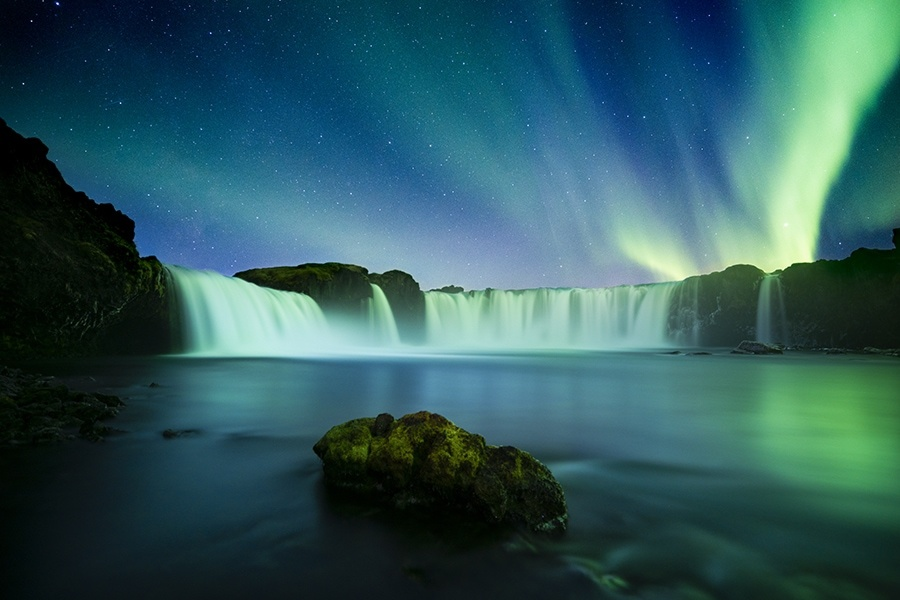 Northern Lights over waterfall