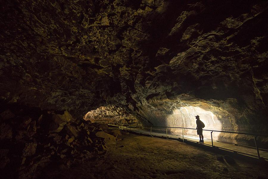 A man inside a lava tube, Undara QLD