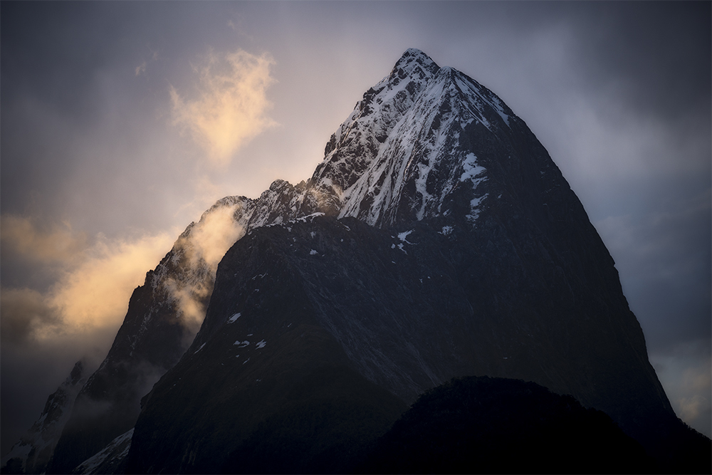 Sunset over a snow capped mountain in Fiordland NZ