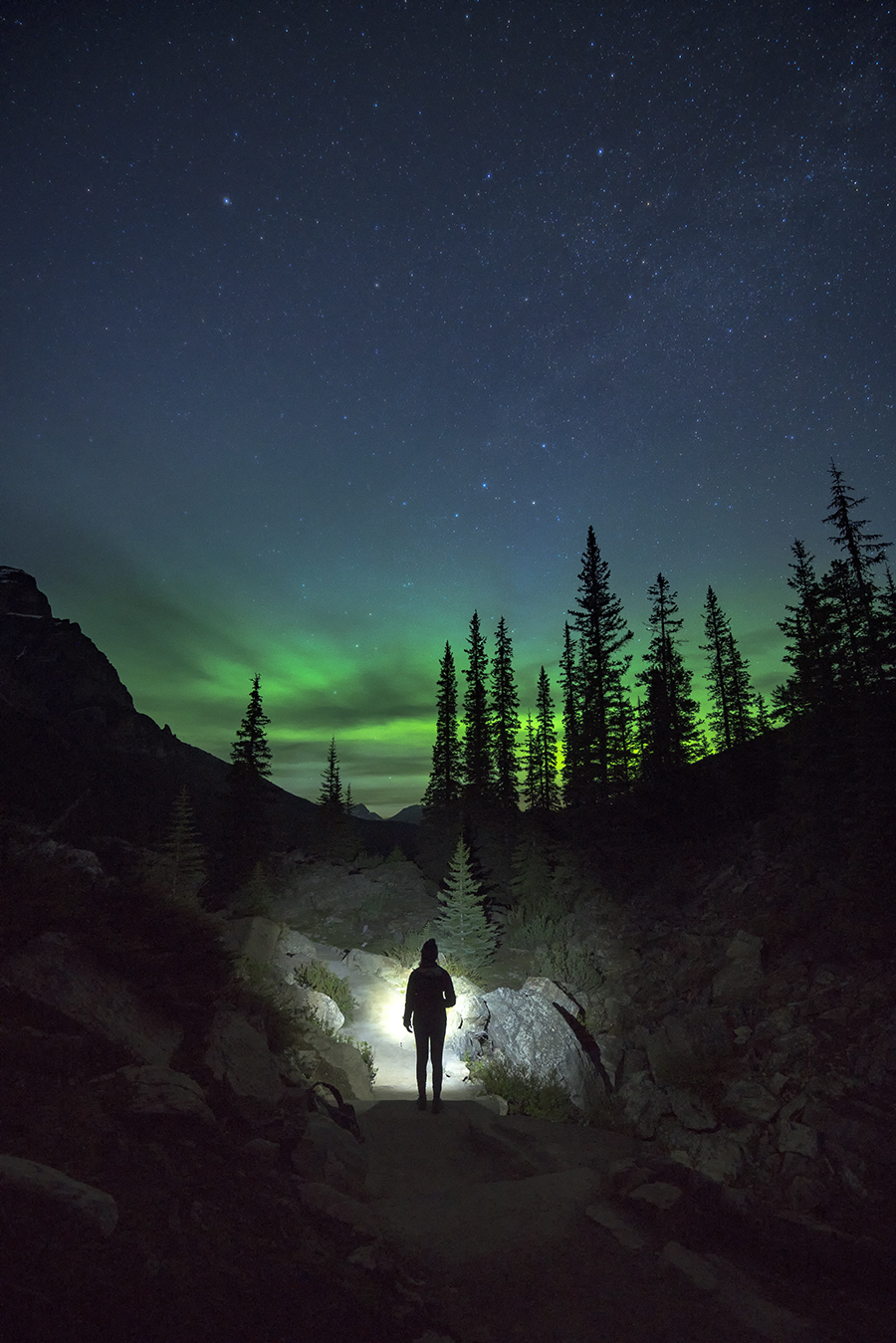 Northern Lights glowing above the mountains