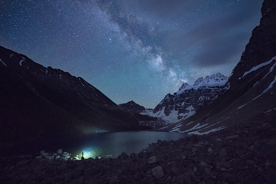 The Milky Way shining above a mountain and lake