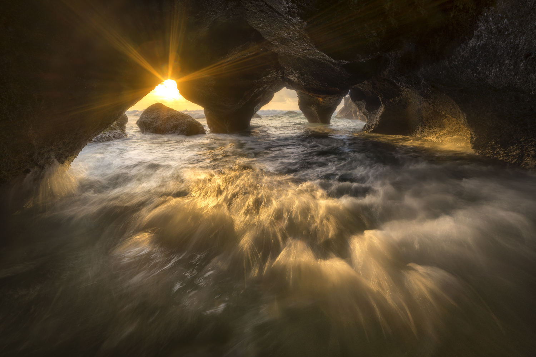 Sea cave sunrise