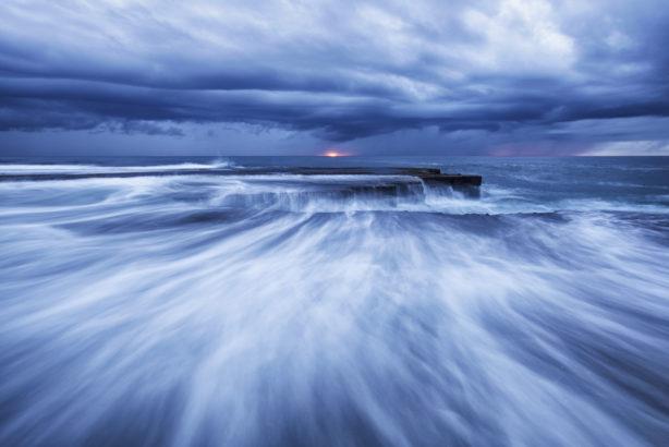 Sunrise over the rushing ocean