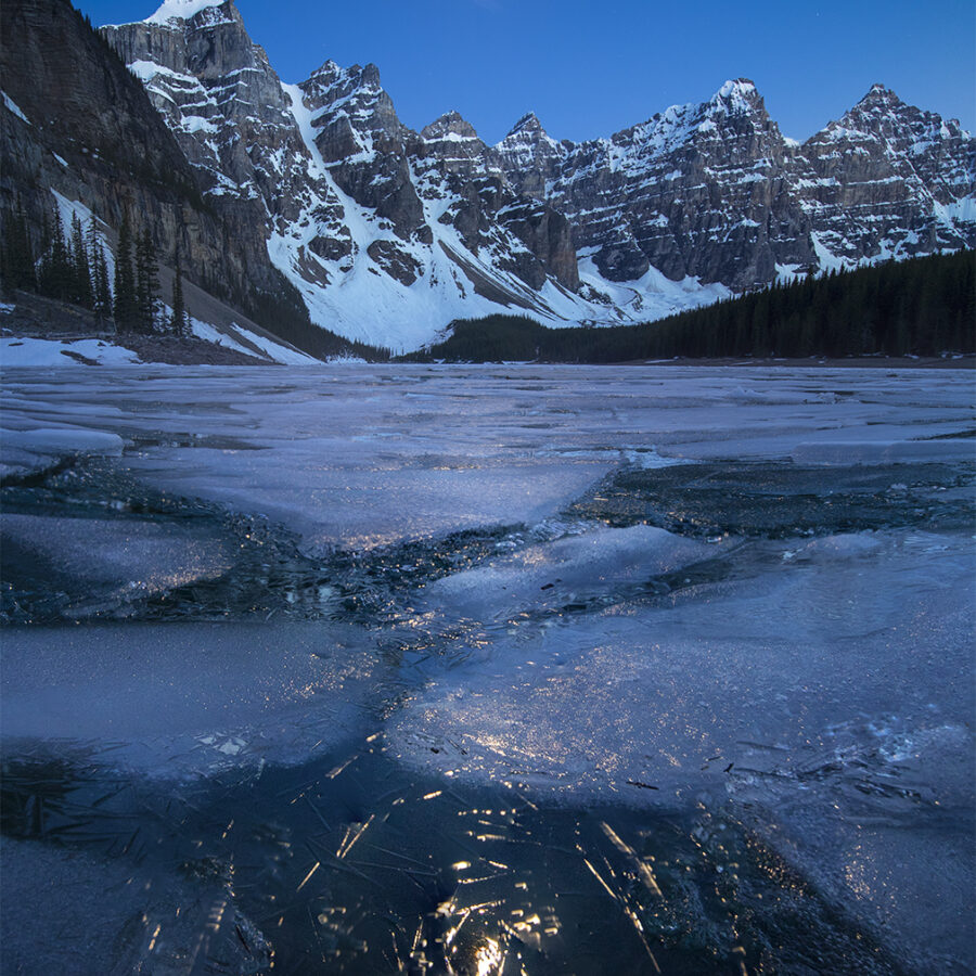 Moonlight above frozen Moraine Lake Alberta Canada