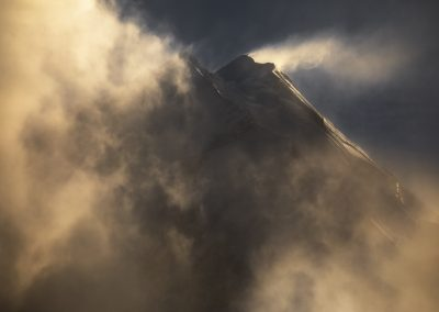 Snow drift from a shrouded mountain peak.