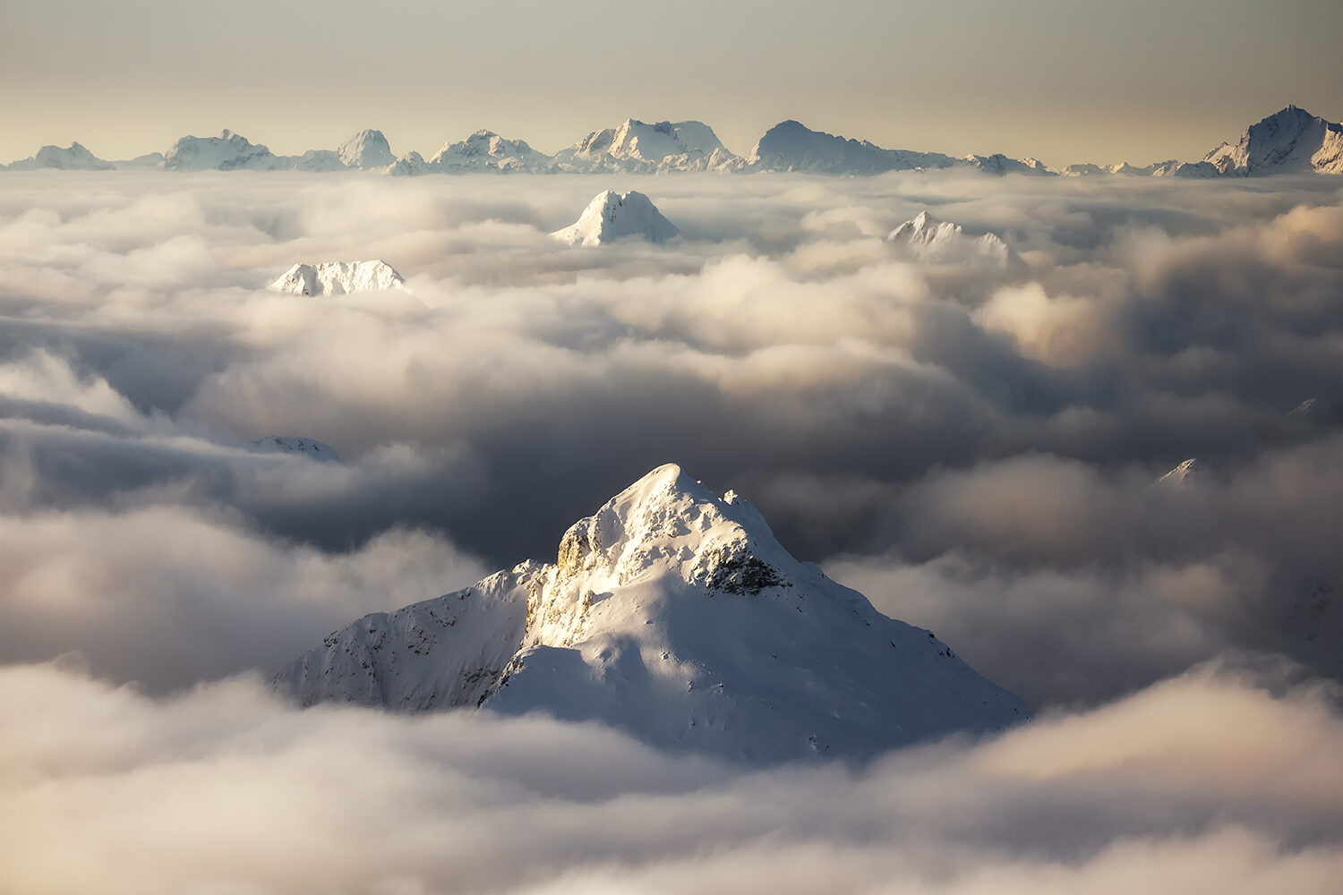 Mountain peaks above a sea of cloud