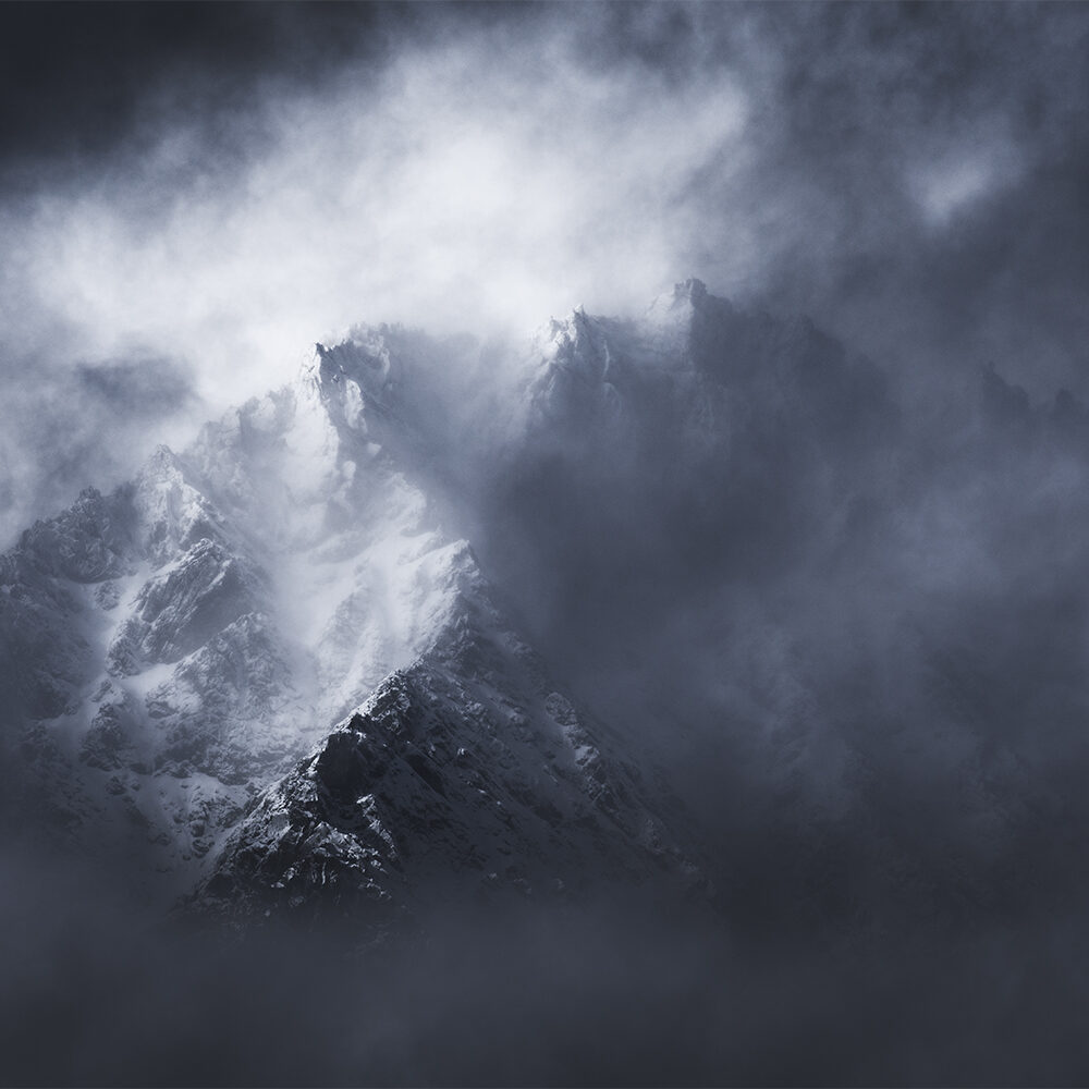 Mountain emerging from cloud