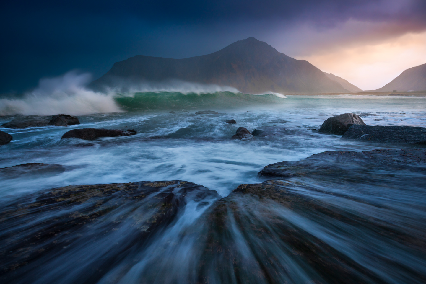 Large swell and mountains by the sea. Lofoten Islands, Norway.