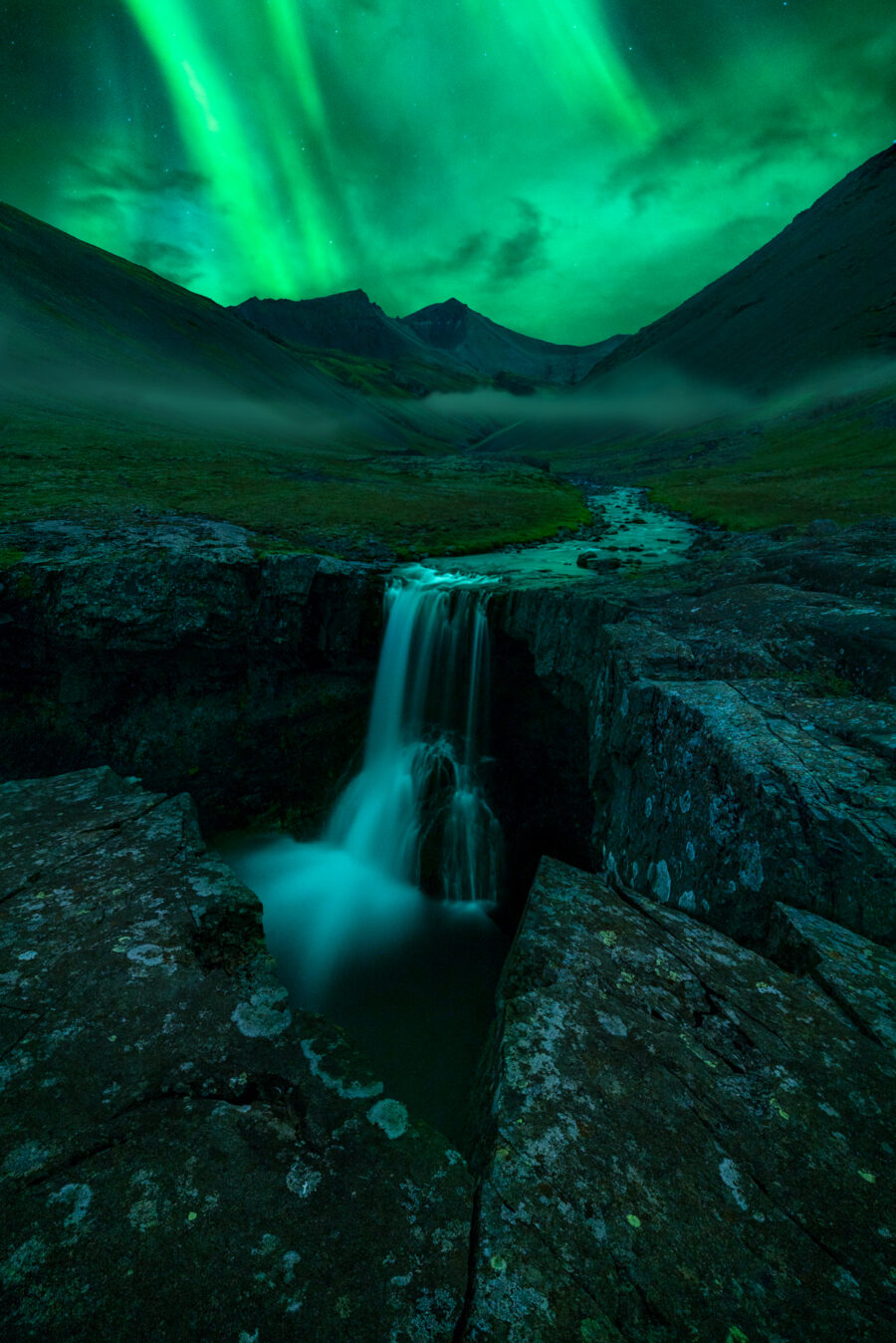 Northern lights over a waterfall in Iceland
