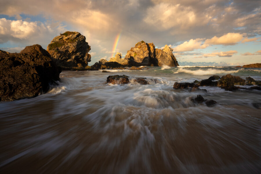 Rainbow by Camel Rock at Bermagui. NSW Australia