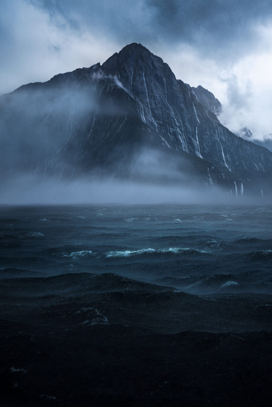 Mitre Peak and waterfalls. Milford Sound heavy rain. NZ.