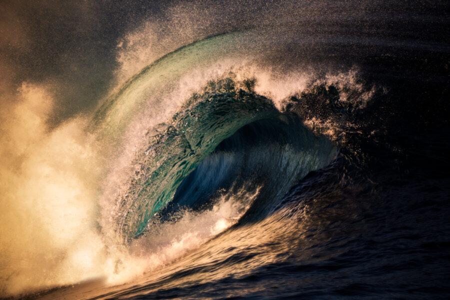Wave crashing at sunset