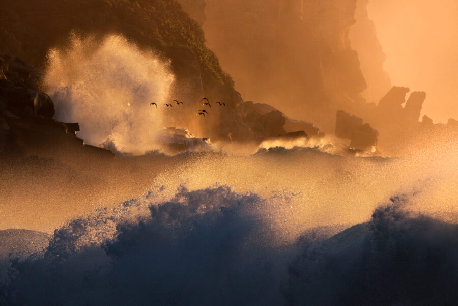 Crashing waves and cliffs at dawn