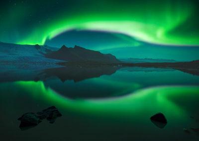 AuroraBorealis-Iceland-Lake-Mountain-WilliamPatino