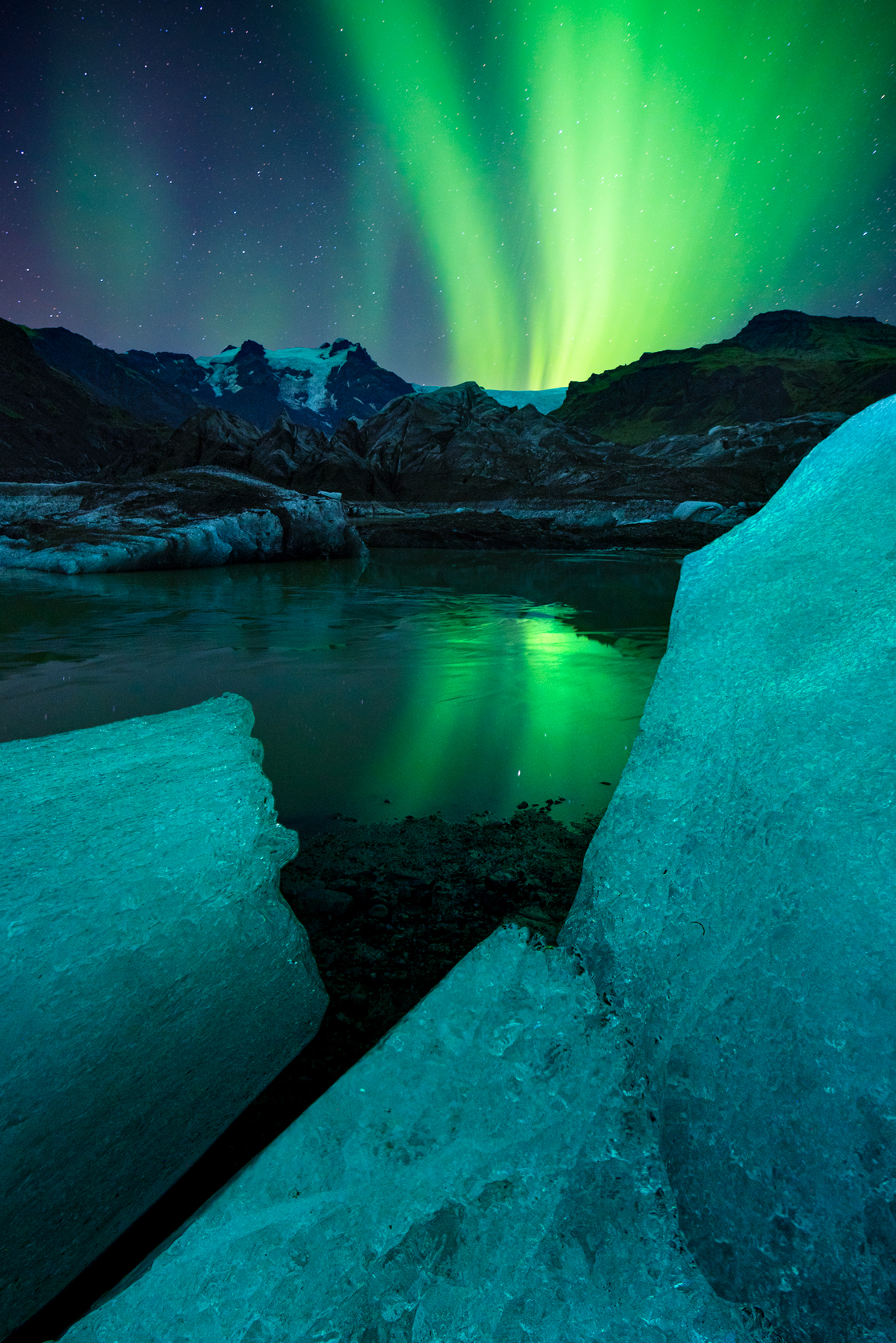 Ice pieces and aurora, Iceland