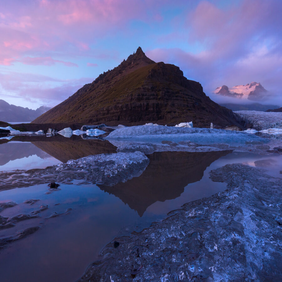 Sunset by a mountain and glacier in Iceland. Svinisfellsjokull.