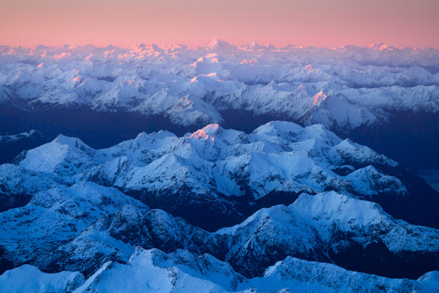 Layers of snow covered mountains